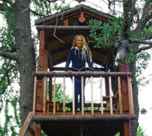 Cate in her custom treehouse